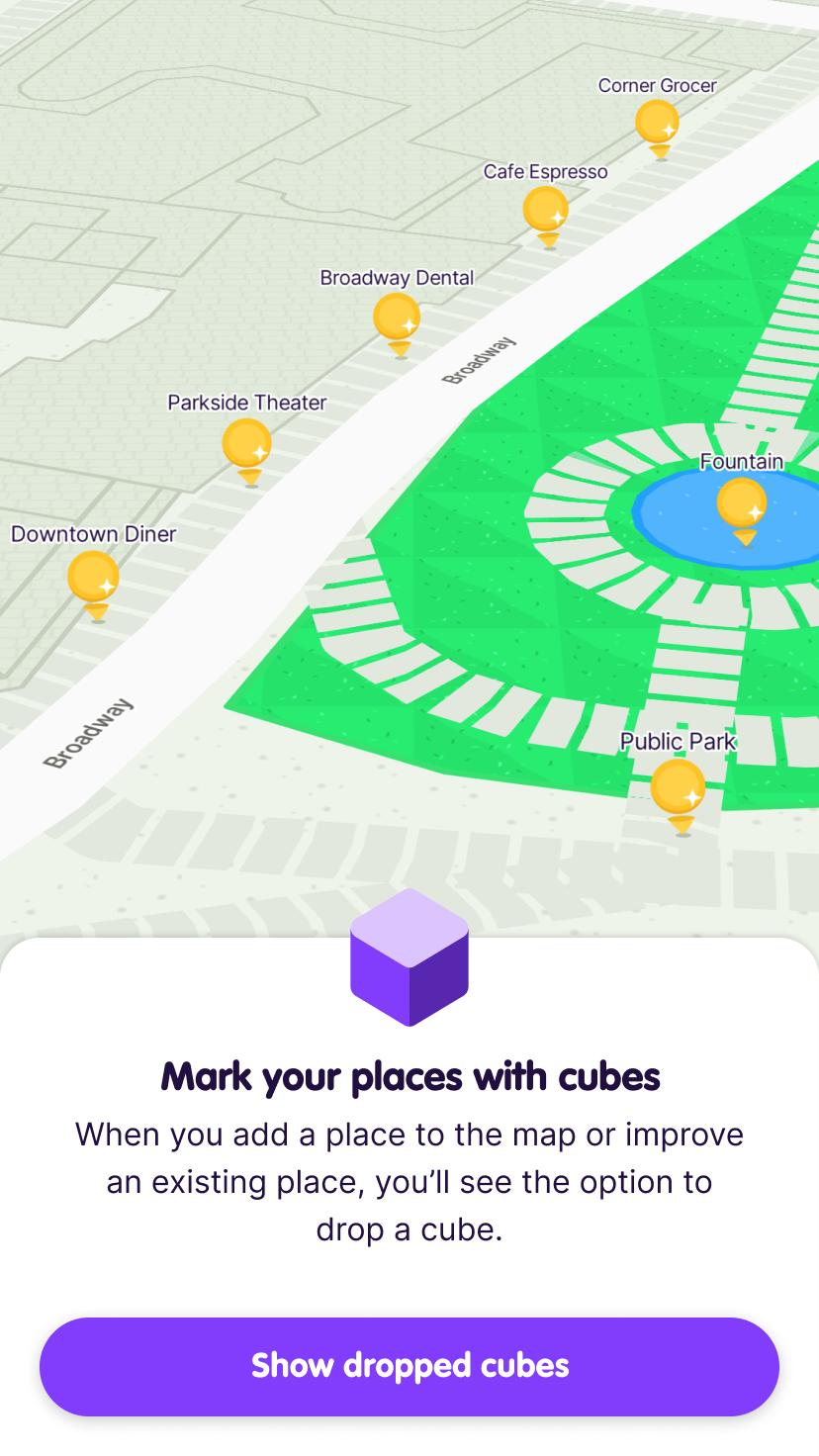 Screenshot from the app intro showing nearby places available for points on the map and prompting the user to tap a button to Show dropped cubes.